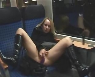 Blonde toying herself in both holes on train