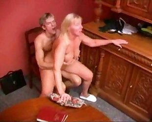 Mature teacher gives boy a private lesson