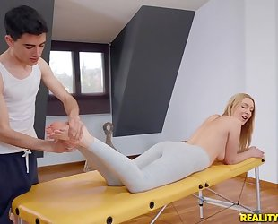 Fit blondie gets oiled up and fucked by her masseur