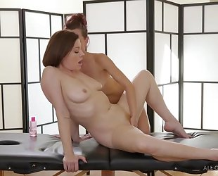 Two insatiable lesbians licking passionately during a massage